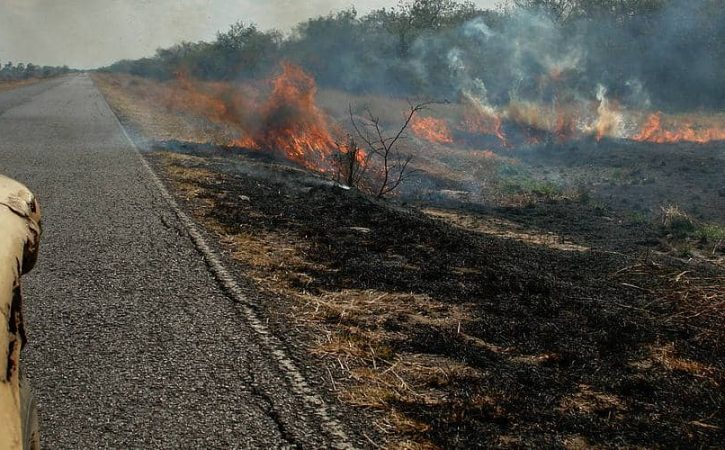 Overland trip in Paraguay; driving through forest fires