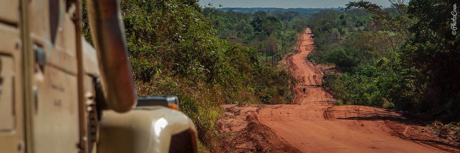 Overland Travel in Paraguay; red roads, green vegetation
