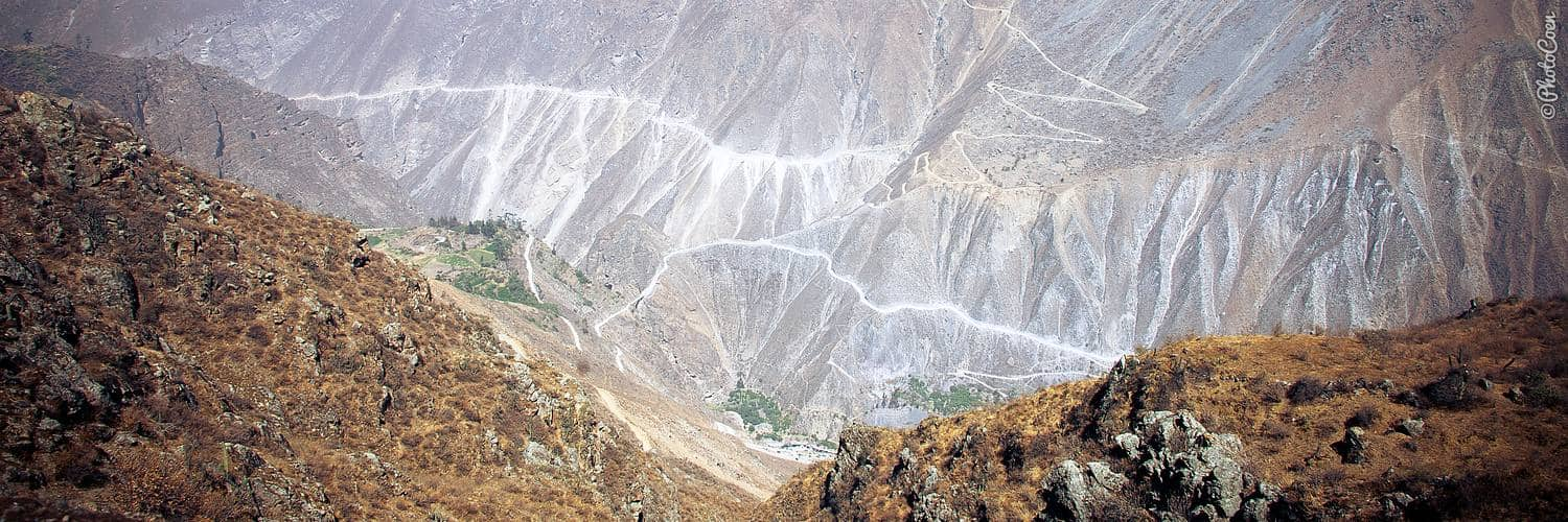 Travel overland in Peru; the vertical mountainsides
