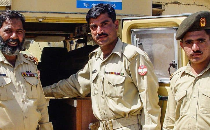 Overland road trip; meeting police officers in Pakistan