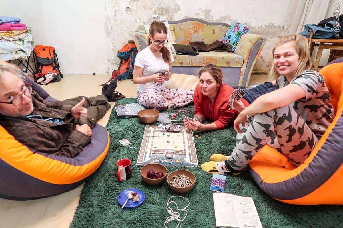 Feeling welcome in Vladivostok; here three women and a man in a living room playing a board game