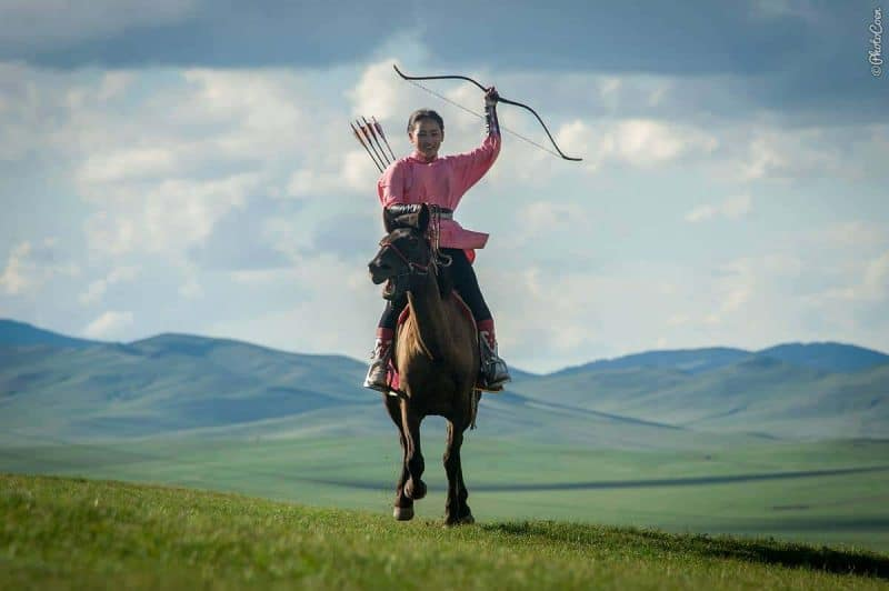Archery in Mongolia, woman on horse