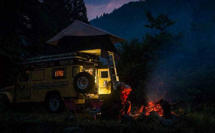 Overlanding story telling around a campfire