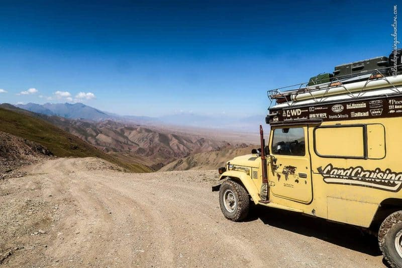 unpaved road, yellow Land Cruiser