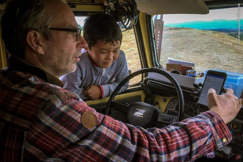 A young Kyrgyz visitor checking out the inside of the Land Cruiser