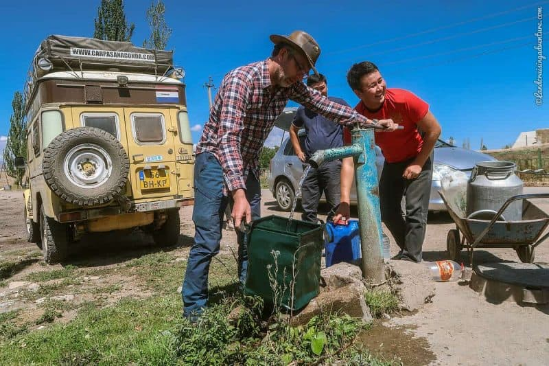 Taking water from a water pump in Kyrgyzstan