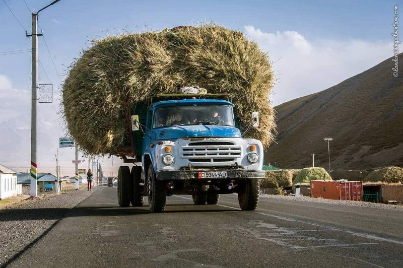 Driving in Kyrgyzstan - Blue truck loaded with hay