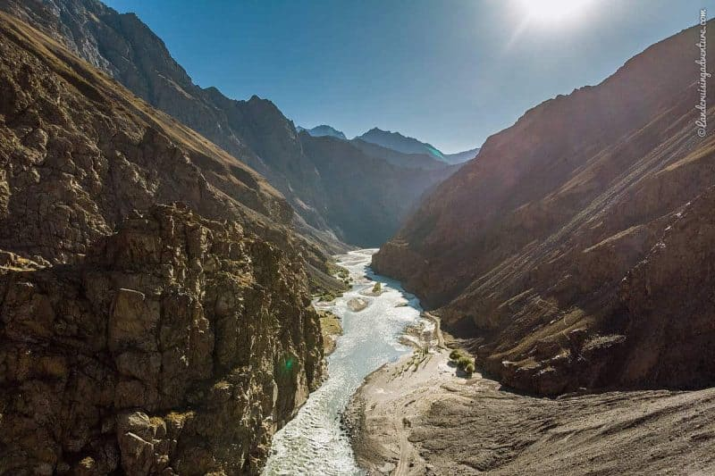 view of the Bartang Valley with bare mountains and a raging river, Tajikistan