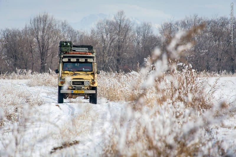 Overland road trip with the Land Cruiser in winter landscape of Kazakhstan