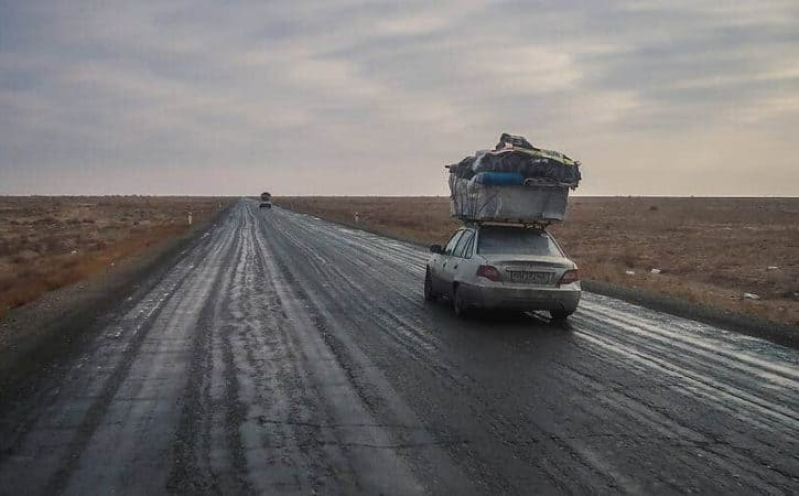 Overland Uzbekistan, empty roads through desert