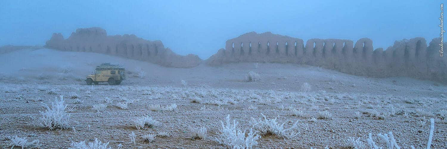 Overland Camping in Uzbekistan - camp in winter next to ruins